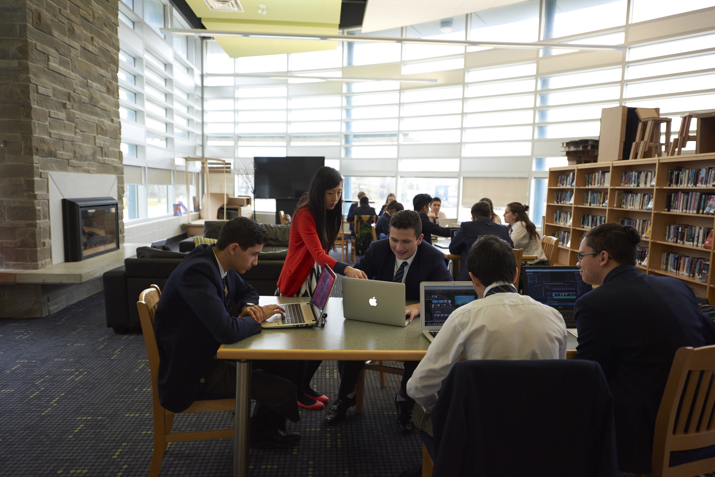 upper school students working in the library