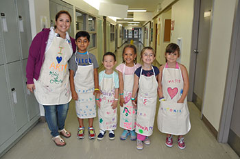 Students in aprons for cooking