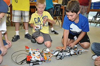 students playing with robots